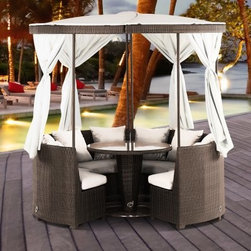Domus Ventures Coco Island Gazebo Patio Dining Set - Seats 4 - Sharing a meal is an intimate affair; and with the Domus Ventures Coco Island Gazebo Patio Dining Set - Seats 4, you and your fellow diners can have all the privacy you require, right out in your own yard. This beautiful patio set adds an element of the exotic to your outdoor living space, through both its visual appeal and its cloaked interior. The canopy curtains can be dropped to provide protection from the sun, wind, bugs, or chill night air, while truly creating an outdoor room that also offers a bit more privacy. And with the curtains drawn and tied back, this gazebo still achieves the same vertical aesthetic appeal of an islander tent, while also allowing a refreshing breeze to circulate. Even the top of this gazebo reflects a holistically positive atmosphere with its yin-yang sectional combination, as guided by the principles of feng shui, which believes adding circular structures such as this to outside spaces promotes positive chi. And for even greater versatility and openness, the canopy can be removed all together, or the sectionals can be separated to increase party flow or to open up the structure and give access to additional guests. So that the central table isn't easily knocked about as company climbs in and out of the booth, its glass top and stainless steel base help to balance and anchor the table and everything resting on it.Made from hand-woven synthetic wicker, this dining set is constructed for outdoor use in any climate. This unique fiber is not just outstandingly weatherproof, safeguarding against fading, cracking, splitting, and molding - it is also dirt resistant, making it easy to clean and maintenance free. The high-density polyethylene composition is also environmentally friendly and 100 percent recyclable. Lastly, the high quality of care that goes into this superior construction means that these pieces will last for years to come, which is good for the environment and good for your wallet.DimensionsTable: 35.43 diam. 28.74H inchesSectional: 48.43W x 26.77D x 31.89H inchesFully assembled Gazebo: 80.71 diam. x 49.21H inchesAbout Domus Venutures Pte. Ltd.Established in 1997, Domus Ventures is a German-owned manufacturer that has grown into a dominant global player in the furniture industry. Exporting over 1,600 containers annually, each design and each piece is subjected to the highest level of scrutiny, ensuring the company's commitment to excellence. Often using materials such as teak, natural wicker, loom, paper fiber, and resin wicker, Domus Ventures is always exploring and testing new materials to find beautiful and sustainable high-quality designs while striving to produce unique modern and contemporary furniture that creates the perfect setting for your home and lifestyle, whatever your taste, budget, or needs might be. Despite their growth into a company that employs over 2,200 factory and office staff in China, Indonesia, Singapore, Germany, and the United States, Domus Ventures prides itself not just on its products but also on its ethical production, which includes decent worker benefits and compensation as well as ecofriendly green initiatives.