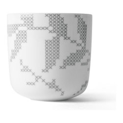 MENU - Thermo Cup, Grey Leaves - Fashion and function: A cup that fits into the palm of your hand. Enjoy your favorite drink in this artisan-designed porcelain cup. Its delightful gray-leaf design features a traditional, Danish cross-stitch pattern. Go ahead — fill your cup to the brim.