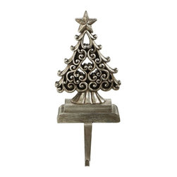 Home Decorators Collection - Tree Stocking Holder - The curling details and antique champagne finish of our Tree Stocking Holder will bring classic holiday charm to your mantel. Capped by a five-pointed star and settled on a solid, graduated base, this hanger will support your stocking in style. Tree in champagne finish. Iron base. Supports up to 2.2 lbs.