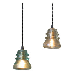 Insulator Pendant Light, Aqua or Clear Glass, Aqua, Fixed - These are a great statement light and are perfect for hanging a couple over a kitchen island. The insulators are all in great condition and free from cracks. We paired these with a black cloth twisted cord to continue with the vintage/antique look. These give off a nice glow with a low watt bulb.