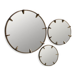 Hollywood Regency - Retro Hollywood design makes this trio of glamorous wall mirrors really stand out. Each pristine mirror is encircled by a band of antiqued brass metal, while sundial-style triangles appear to hold the spherical mirrors in space. Display all three together on one wall within your modern home for a striking look, or hang them throughout your interior to create a stylish theme.