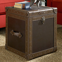 "Hammary - Hidden Treasures Trunk Cube - Hammary's Hidden Treasures collection is a fine assortment of unique accent pieces inspired by some of the greatest designs the world over. Each selection is rich in Old World icons and traditions. Every piece in this collection is crafted with the upmost attention to fine details. Each item is a work of art from brass nailhead trim and exquisite hand-painting to elegant shaping and decorative trim. Wide varieties of materials are used to create a perfect look and fine quality which includes exotic woods, leather, and stone to raffia and glass. The wide variety of finishes, hardware, beautiful carvings and other final touches offer unmatched versatility for any room in your home. Hidden Treasures features cocktail tables, occasional and accent pieces, trunks, chests, consoles, wine racks, desks, entertainment units and interesting storage pieces. Place one in a comfortable reading nook. . . in the family room for flair and variety. . . in the foyer for a welcome look. . . in a bedroom for a cozy style. . . or in the office for function and versatility. The pieces in this collection mix beautifully with any decorating style and will easily become the focal point in any setting.; Hidden Treasures Collection; Finish:; Dark brown PVC; Casters; Antique brass nailhead trim and hardware; Vent holes; Decorative handles; Pneumatic hinges; Weight: 52 lbs.; Dimensions: 18""W x 18""D x 21""H"