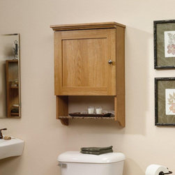 Sauder - Sauder Bath Sundial Collection Wall Cabinet Multicolor - 414060 - Shop for Bathroom Cabinets from Hayneedle.com! The Sauder Bath Sundial Collection Wall Cabinet is a smart way to organize the things you need so you'll spend less time looking for the tweezers and more time doing the things you love! This attractive storage solution features quality construction made up of rugged MDF and faux granite that's protected by a clear EverSheen top-coat that defends against heat stains and scratches. The molded top and framed door of this highland oak piece looks fantastic and is accented all the more by an open shelf finished in faux granite. Last but not least the door which you can install to open to the left or right hides a single adjustable shelf that makes it easy for you to customize how you organize. Order this easily mounted bathroom furnishing the perfect marriage of form and function.About Sauder Woodworking Co.Sauder Woodworking Co. is North America's leading producer of ready-to-assemble (RTA) furniture and the nation's fifth largest residential furniture manufacturer. Based in Archbold Ohio Sauder also sources furniture from a network of quality global partners including a line of office chairs that complement its residential and light commercial office furniture. Sauder markets more than 30 distinct furniture collections in a full line of RTA furnishings for the home entertainment home office bedroom kitchen and storage. Sauder is a privately held third-generation family-run business. The company prides itself on its awareness that all function and no fashion makes for a dull living space when it comes to home furnishing products. That's why Sauder's award-winning design team has produced more than 25 collections of stylish furniture that span the design spectrum. From minimalist modern or contemporary to classic 18th century or country styles Sauder has what you're looking for. The company offers more than 500 items - most priced below $500 - that have won national design awards and generated thousands of letters of gratitude from satisfied consumers.