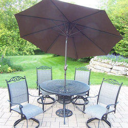 Oakland Living - 7-Pc Patio Rocker Dining Set - Includes dining table, four swivel rockers, 9 ft. tilt crank umbrella with stand and metal hardware. Fade, chip and crack resistant. Durable, handcast and lightweight. Hardened powder coat. Warranty: One year limited. Made from sling and tubular aluminum. Black color. Minimal assembly required. Table: 48 in. Dia. x 29 in. H. Chair: 24 in. W x 30.5 in. D x 40 in. H (16 lbs.)The Oakland Cascade Collection combines style and modern designs giving you a rich addition to any outdoor setting. The Oakland Cascade Collection adds functionality and ease of use. The Oakland Cascade collection is perfect for any outdoor patio, back yard or garden. This dining set will be a beautiful addition to your patio, balcony or outdoor entertainment area. Our dining sets are perfect for any small space, or to accent a larger space.
