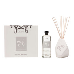 Joya - Bois de Rose Diffuser Set - Black currant, wild cardamom, artemisia and marigold petals combine to create a fragrance unlike any other. Holding these exquisite scents together is an asymmetrical ceramic vase, designed in partnership with artist Sarah Cihat and featuring an acorn motif.
