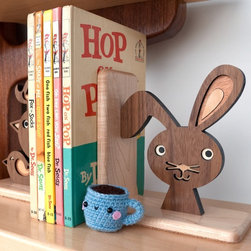 Woodland Bunny Forest Animal Bookend By Graphic Spaces - The rabbit is holding up the books with his one ear — I love this for a kid's room!