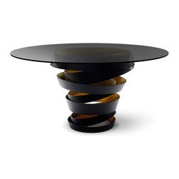 KOKET Intuition - The two tone metal ribbon of the Intuition dining table evokes the mysterious and divine feminine instinct. Carefree & unexpected swirls are guided by emotions and desires . Matte black metal swirl with metallic