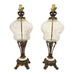 Norman Creation Brass Glass Lamps, Pair - Pair of Norman Creations table lamps with bras-plated finish and clear glass bases.