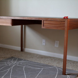 Stephanie desk - This desk is inspired by chinese furniture and the parson's table. The form is ultra simple and clean, but the details make the desk stand out. The drawers are hand cut dovetails and slide on wooden guides. The top is leather that's been inset. I believe this top gives a warm contrast to the all sipo mahogany desk.