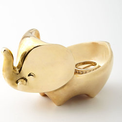 """Jonathan Adler - Brass Elephant Ring Bowl - Jonathan AdlerBrass Elephant Ring BowlDetailsHandcrafted elephant ring bowl.Made of brass.3.75""""W x 2.5""""D x 1.75""""T.Imported.Designer About Jonathan Adler:Potter designer and author Jonathan Adler launched his first ceramics collection in 1994. His design philosophy: create a foundation of timelessly chic furniture and accessorize with abandon. With his roots still firmly in pottery he has expanded to become a complete lifestyle brand offering furniture lighting decorative objects fashion accessories and more. He is dedicated to bringing style craft and joy to life."""