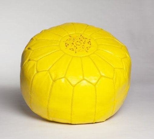 Lemon Yellow Leather Pouf - Don't underestimate the power of adding lemon yellow to your space. I adore this yellow leather Moroccan pouf for its practicality and liveliness. It would be a great color punch in a neutral living room or a bit of fun for any bedroom or children's space.