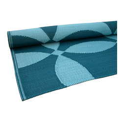 KOKO - Petal Print Floor Mat, Teal and Turquoise - What a modern-looking floor mat. It would be just as pretty in the kitchen as it would be welcoming guests at the front door. The design feels fresh and it's a breeze to keep clean since it's made of polyurethane.