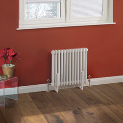 Hudson Reed - Traditional Column Radiator Cast Iron Style White 23.6 x 23 & Valves - Hudson Reed Traditional 13 x 3 Column Radiator Cast Iron Style White 23.6 x 23This cast iron style radiator, with a high quality white powder coat finish (RAL 9016), has 13 vertical triple columns that give a massive heat output of 1,014 Watts (3,457 BTUs), ample to warm a room quickly and effectively.When combined with a set of modern valves, this up-to-date version of a classic radiator design is an ideal complement to contemporary settings, but also fits in well with traditional décor. This versatile radiator is compatible with all domestic central heating systems, will connect with your existing pipe work and is supplied complete with a wall mounting kit. For a truly authentic look, combine this traditional-style radiator with a Hudson Reed floor mounting kit (TRUSH017).Traditional Column Radiator Cast Iron Style White 23.6 x 23 Details  Dimensions: (H x W x D) 23.6 (600mm) x 23 (585mm) x 4 (100mm) Projection When Fitted: 5.1 (130mm) Output: 1,014 Watts (3,457 BTUs) Material: Steel Finish: White Powder Coat (RAL 9016) Columns: 13 x 3 Wall Mounting Brackets Included Please note: Angled Radiator Valves are required, please choose from the options above.  5 Year Guarantee on materials and finish Please Note: Our radiators are designed for forced circulation closed loop systems only. They are not compatible with open loop, gravity hot water or steam systems.