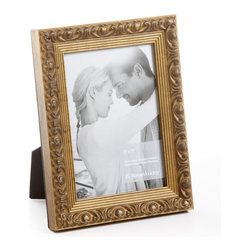 """Origin Crafts - Vintage gold wood picture frame - Vintage Gold Wood Picture Frame Amongst the twenty arrondissements or districts that make up Paris there is a former fortress which stands proud as the focal point of district number one ? the Louvre. A majestic masterpiece where priceless art is encased in classic elegance, founded in the spirit of authentic French tradition. It was here in the Louvre, inspired by its magnificence and contribution to modern culture that Vintage was born. Dimensions (in): Width: 1 1/4, Height: 1 Holds (4""""x6"""", 5""""x7"""", 8""""x10"""") photos. By Roma Moulding - Roma Moulding uses only the highest quality materials. Roma owes it?s renown to exquisite details: meticulous applications of gold and silver leafing, genuine woods, exotic veneers, patinas, superior lacquers and finishes all done by hand. Roma employs time proven techniques to achieve the stunning finishes other manufacturers strive to achieve. Ships within Five Business Days."""