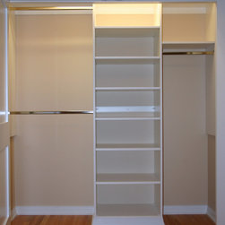 Basic reach in closet - This photo shows an ideal starting point for a reach in closet from 5' - 10' wide. Three sections allow flexibility to maximize and organize for anyone, by providing double hanging, shelving, and long hanging sections. This design provides more hanging than the standard shelf and pole closet. And the various shelves offer the ability to divide and conquer the shambles usually found piled on a single shelf or the floor.