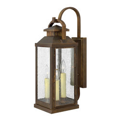 Hinkley Lighting - Hinkley Lighting Revere Traditional Outdoor Wall Sconce X-NS5811 - This Hinkley Lighting Revere Traditional Outdoor Wall Sconce combines metropolitan style with timeless elegance. It has a simple, solid brass frame in a sleek and smooth Sienna finish with panels of clear seedy glass. It's a lantern-type, three-light fixture that hangs from a hook, and has a casual yet stylish look and feel.