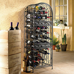 "Wine Enthusiast Companies - Renaissance 50 Bottle Wine Rack - Guard your wine in grand style. Ornate scrollwork with antique bronze finish evokes the artistry of the Renaissance, a fitting setting for your wine. Holds 45 standard Bordeaux-size bottles behind the slide-lock door. Features: -Wine jail.-Material: Wrought iron.-Finish: Antique bronze.-Product Type: Wine Bottle Rack.-Collection: Wrought Iron.-Finish: Antique bronze.-Distressed: No.-Material: Wrought iron.-Mount Type: Floor.-Wine Bottle Capacity: 45.-Lockable: Yes.-Handle Design: Finger pull.-Shelves Included: Yes -Number of Exterior Shelves: 12.-Adjustable Shelves: No..-Lighted: No.-Plug-In: No.-Removable Serving Tray Included: No.-Ice Bucket Included: No.-Wine Glass Storage Included: No.-Glasses Included: No.-Adjustable Levelers: No.-Stackable: No.-Foldable: No.-Removable Bottle Racks: No.-Bottle Size Compatibility: 750 mL.-Eco-Friendly: Yes.-Product Care: Wipe clean with damp cloth.-Door Attachment Detail: Hinges.-Refrigerated Cabinet: No.-Mirrored Back: No.Specifications: -UL Listed: No.-cUL Listed: No.-ISTA 3A Certified: No.-ISO 9000 Certified: No.-ISO 14000 Certified: No.Dimensions: -Overall Height - Top to Bottom: 48.5"".-Overall Width - Side to Side: 16.25"".-Overall Depth - Front to Back: 10.56"".-Shelves: -Shelf Depth - Front to Back: 10.56""..-Overall Product Weight: 50 lbs.Assembly: -Assembly Required: Yes.Warranty: -Product Warranty: 30 Days."