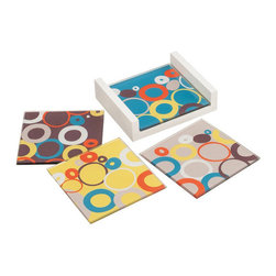 Ring-a-Ding Coasters - Your drinks get a cool place to rest on these nifty mid-century inspired coasters. Each in a fun retro shade, they're covered in playful rings and rounds for a splash of color during social evenings.
