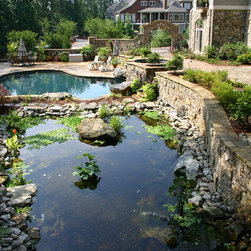 Pools - This large pool is free form constructed of gunite, lined with Pebbletec, has a salt genartor system. It has an elevated spa that spills into the pool. The large Koi Ponds and waterfalls appear to connect to tyhe pool, but are actualloy separate.