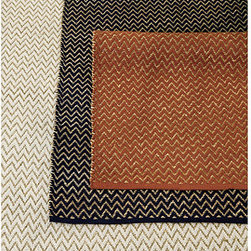 Ballard Designs - Raleigh Natural Fiber Rug - Swatches available. Sizes are approximate. Imported. Our Raleigh Rug captures the fashion-forward look of chevrons in natural fiber. We're seeing the stylish pattern everywhere, from Paris boutiques to home fashions. Casual and fully reversible, this go-anywhere rug is woven in a horizontal chevron of cotton and natural jute. Use of a Rug Pad is recommended.Raleigh Natural Fiber Rug features:  . . .