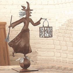 Iron Witch Weathervane with Votive - Add a bit of bewitching style to your holiday decor. This rustic metal witch stands atop a pumpkin, broom and cobwebbed lantern in hand, ready to create a frightful Halloween focal point for many spooky holiday seasons to come.