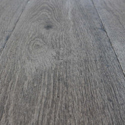 """Vintage French Oak - Our Aged French Oak planks with various finishes, distress levels and antique patinas.  These French oak planks simulate antique, worn and bleached French Farmhouse oak planks with their vintage character.  Up to 10"""" wide boards and the option of an engineered subfloor makes these planks ideal for every installation scenario.  Finished with a matte drying oil they are ready to be walked on.  Vintage Elements recommends an oil refresher or wax to finish these boards after installation to maintain the rustic patina."""