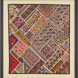 Antique Cloth Wall Art - Fragments of intricately crafted vintage garments patchwork a cultural museum of the textile traditions of India, Pakistan and Afghanistan. Each piece was part of a handmade dress, dating back some 60 to 70 years, exhibiting vivid natural dyes, exceptionally detailed patterns and beautiful needlework. Our exclusive wall art arranges the swatches in an artistic presentation, coordinating shapes and colors into a stunning whole. Composed cloth is displayed on a sand-colored mat and framed under glass in a black wood frame. Each wall art is unique. Vintage fabrics may show wear and slight discoloration.