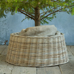Basket Tree Skirt - Bring in the ultimate enchanted forest accoutrement: a real tree! I love the idea of picking out a second (much smaller) Christmas tree to keep in the bedroom. This basket tree skirt is perfect: rustic, simple and chic.