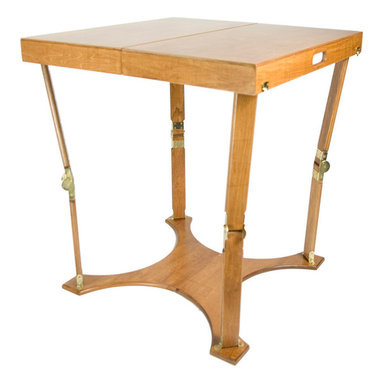 "Spiderlegs - Spiderlegs Handcrafted Portable Wooden Folding Cafi Table, Warm Oak Finish - Spiderlegs Hand Crafted portable wooden folding table with a patented folding design and original locking hardware. Crafted from Baltic Birch and finished in a warm oak color, the collection includes a Natural Birch, Warm Oak, or a Red Mahogany stain finish, all with a polyurethane top coat for a fine furniture finish. The table is designed to accommodate up to four adults. Table folds like a suitcase for easy storage and has its own built in handle for easy for transport. The folded dimensions are 30"" x 15"" x 4.75"". The unique folding table base adds stability and flexes slightly with moderately uneven surfaces (prevents rocking common to caf��_��_ pedestal tables). Items such as table cover, picnic supplies or paperwork can be stored or carried in spaces inside the folded table. The locking hinges prevent the table from collapsing when opened. Each leg has been tested to support more than 75 pounds (recommended load limit). Hinge locks may be easily released by pressing the solid brass lock buttons between the thumb and a finger. The table may be used indoors or outdoors and is built 29 inches high to be more compatible with the height of a typical dining table. On carpeted surfaces the base allows the table to be moved (slid) without lifting the table, a useful feature for partially completed puzzles, projects, or scrapbooks. Uses include extended dining, games, cards, puzzles, travel (RVs, motel table), extra desk space, elegant camping and tail gate parties, exhibitions and displays, picnics, patio dining, events. Often used as a dining table in small apartments and condos without dining rooms. Can be store under a bed, stand up in a coat closets, on a shelf. With the attractive furniture finish storing the table in a visible location may be desirable. Clean with a damp cloth. Renew wood surfaces with wood care products. US Patent numbers 6,779,466 and 7,337,728. European Patent Number 1 466 644. The table includes a full one year warranty. Folding Caf��_��_ Table (1)"