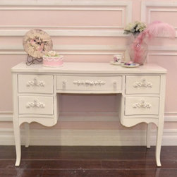 Chic White 5 Drawer Desk with Lovely Rose Appliques - This lovely shabby white desk features five drawers with two on each side and one in the subtle, curvy legs, and a gorgeous white finish. The whole piece is set off by our rose appliques and glass knobs. Perfect for the cottage bedroom or home office!