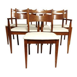 "Pre-owned Mid-Century Modern Dining Chairs - Set of 6 - Mid-Century Modern dining chairs in walnut set of six with heavy cream upholstery in great condition, two captain chairs and four side chairs. This set features a rich warm brown finish and cream seats.    Captain's chair: W 22"" x D 19"" x H 31""1/2. Seat H 17""1/2  Side chair: W 20"" x D 18"" x H 31""1/2. Seat H 17""1/2"