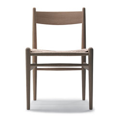 Wegner CH36 Chair - This classic dining chair has major mid-century Scandinavian style. Its woven seat and light wood will be a wonderful addition to any dining table or desk.