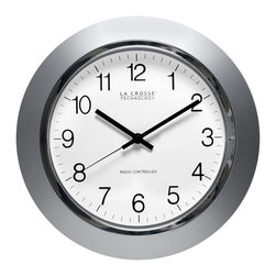 None - 14-Inch Atomic Analog Clock - This atomic analog clock keeps accurate time while adding an attractive accent to your wall. The 14-inch clock features a sleek silver frame with a chrome rim. This clock will conveniently update the time to accommodate daylight savings.