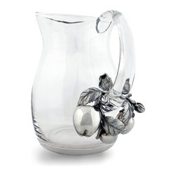 Apples Pitcher - Breathtaking pewter work elevates this well-drawn but simple glass pitcher to a handsome showpiece of the harvest and a proud vessel for presiding over the breakfast table.  Serve fresh cider from the Apples Pitcher to contrast the cool greys of the wreath of leaves and fruit on its handle, or use it to hold a handful of grasses for a permanent orchard-themed arrangement.