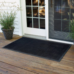 "Frontgate - Rubber Brush Door Mat - Industrial-grade rubber fingers yield a reflexive scraping motion when pressure is applied. Suction cups on underside hold mat firmly in place. Molded beveled edging creates a retention dam that traps water and protects floors. Our Rubber Brush Door Mat scrapes damp, dirty shoes clean with thousands of rubber ""fingers"" that remain flexible in the most frigid weather conditions. This mat is the perfect year-round outdoor entrance mat for your high-traffic areas. . . . Made in USA."