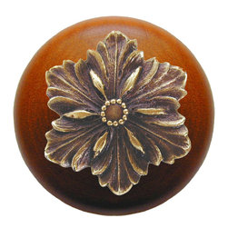 """Inviting Home - Opulent Flower Cherry Wood Knob (antique brass) - Opulent Flower Cherry Wood Knob with hand-cast antique brass insert; 1-1/2"""" diameter Product Specification: Made in the USA. Fine-art foundry hand-pours and hand finished hardware knobs and pulls using Old World methods. Lifetime guaranteed against flaws in craftsmanship. Exceptional clarity of details and depth of relief. All knobs and pulls are hand cast from solid fine pewter or solid bronze. The term antique refers to special methods of treating metal so there is contrast between relief and recessed areas. Knobs and Pulls are lacquered to protect the finish. Alternate finishes are available. Detailed Description: The Opulent Scroll pulls add an amazing focus to any drawers or cabinets - it will make them look regal and majestic. The absolute perfect place for these pulls to be used is in the dining room on your china closet. They are great pulls to use if you are trying to punch up an antique piece of furniture or cabinet. You should consider using the Opulent Scroll pulls in combination with the Opulent Flower knobs or wood knobs with flower."""