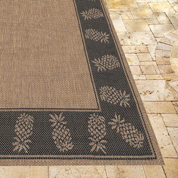 "Frontgate - Oasis Retreat Outdoor Rug in Brown & Black - 3'9"" x 5'5"" - Made from 100% fiber-enhanced Courtron  polypropylene. All-weather rug construction is pet-friendly and mold- and mildew-resistant. Power-loomed flat weave makes it suitable for both indoor and outdoor use. Adds warmth underfoot in cooler temperatures and relief from hot surfaces in summer. Simply hose off outdoor rug to clean. Our Oasis Retreat Outdoor Rug features a solid center panel, artfully surrounded by a pattern of pineapple outlines. Distinctively designed to complement classic outdoor decor, this versatile floor covering is ideal for patios, entryways, and sunrooms.Made from 100% fiber-enhanced Courtron polypropylene. . . . . Made in Belgium."