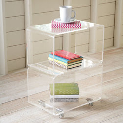 Grandin Road - Acrylic Two-Tier Mobile Table - Two stacked acrylic cubbies form this modern take on an end table. Set on rolling casters with nickel-finished hardware. Smooth, rounded corners. Open in front and in back. Reduce visual clutter with our Acrylic Two-Tier Mobile Table. Your books and magazines will appear to float on the three transparent shelves. Since it's mobile, this table is also useful in a kitchen or office.  .  .  .  .