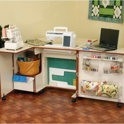 Kangaroo Kabinets - Kangaroo Kabinets Wallaby Sewing Cabinet with Free Chair Multicolor - K8405-RTA - Shop for Sewing Tables and Cabinets from Hayneedle.com! About the Kangaroo Kabinets Wallaby Sewing Cabinet Small on size but huge on functionality the Wallaby Kangaroo Cabinet by Arrow (formerly by Koala) will have you organized in no time. Constructed of engineered wood and pressboard this cabinet is available in two finishes to best suit your home. When it's folded up this cabinet is no bigger than a standard dresser or buffet but swing open the front doors and you'll instantly create an entire workspace for yourself. When you're done you simply swing the doors shut and lock it up tight. A three-position airlift will hold your sewing machine up to 19W x 9 5/8D inches and this lift moves up and down so your machine is at the right height for you. While your primary machine sits on the lift there's space on the left of the cabinet for a serger or a second sewing machine. A quilt leaf on the back lifts easily expanding your work space for quilts curtains or other large projects. The large door features clear trays to keep your notions well organized and a large drawer on the other side is perfect for fabric or bulkier items. Dimensions: Closed: 39.5W x 19.25D x 30H inches Open: 64.5W x 42.5D x 29.5H inches About Arrow Companies LLCSince 1943 Arrow Companies LLC has been manufacturing top-quality specialty furniture. Located in historic Elkhorn Wisconsin Arrow Companies LLC continually satisfies customers by providing them with classic sewing machine cabinets and craft tables with the multi-functional appeal of stowing and displaying sewing items and serving as tasteful and decorative furniture items. Products of Arrow Companies LLC feature premium engineering quality and are functional and affordable.