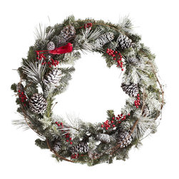 Snowy Pine Wreath - This wreath is so charming and beautiful. Hung on a white picket fence or black front door, it instantly welcomes in the winter months.