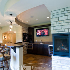 Contemporary Basement by Finished Basement Company