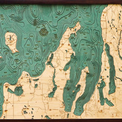 Thos. Baker - grand traverse bay (31w 25h) - Laser cut and hand colored in Baltic birchwood, this dramatic Grand Traverse Bay laser cut marine chart (31w 25h) by Thos. Baker is reproduced from an actual hydrographic survey.  Fully framed in solid wood protected by a durable, ultra-transparent sheet of plexiglass. Fasteners not included.��This item size is��31w 25h.