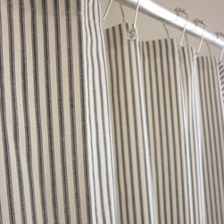 Nautical Ticking Stripe Grommeted Shower Curtain by Modern Folk Shop - Sometimes simply changing your shower curtain is all you need to freshen up your bathroom. I love ticking stripes, and these curtains are handmade in a variety of colors.
