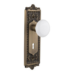 Nostalgic Warehouse - Nostalgic Egg and Dart Plate W/ White Porcelain Knob and Keyhole, Antique Brass - With its distinctive repeating border detail, as well as floral crown and foot, the Egg & Dart Plate in antique brass resonates grand style and is the ideal choice for larger doors. Add a traditional touch with our pure White Porcelain Knob for a simple, yet vintage, look. All Nostalgic Warehouse knobs are mounted on a solid (not plated) forged brass base for durability and beauty.