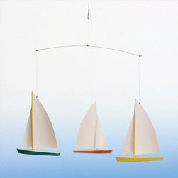 Dinghy Regatta Mobile - Your child's imagination will sail away with this simple yet fascinating sailboat mobile. With the slightest movement, these piece will stay in motion while the base remains firm and still. Packed and ready to hang, your little sailor will be delighted.