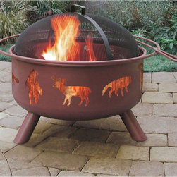 Landmann USA - Landmann Big Sky Wildlife Fire Pit - 28337 - Shop for Fire Pits and Fireplaces from Hayneedle.com! Made of steel and with a Georgia clay sandstone finish the Big Sky WildLife Fire Pit is the perfect choice for a mountain cabin. This fire pit has cutouts in its tall sides that feature images of a mountain lion a moose a fox a bear a deer a wolf a sheep raccoon a buffalo and an elk. When a fire is burning you can see the flames through the mesh-covered cutouts. When you want to cook outdoors you can use the full-size enamel cooking grate. A mesh lid for safety and a poker for stoking the fire are included.