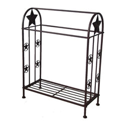 Zeckos - Brown Metal Western Star Quilt Rack - This beautiful metal quilt rack adds a retro Western touch to any bedroom. It has a top bar for hanging quilts, and features a pair of shelves for storing extra shhets and blankets under the displayed quilt. The rack measures 29 inches wide, 18 1/2 inches deep and 36 1/4 inches tall. It can be used indoors or outdoors, and makes a great gift.