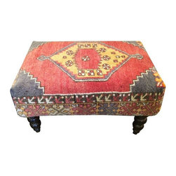 "Pre-owned Antique Rug Small Ottoman - A unique application of an antique rug as an ottoman. The piece is Indian in origin. The rug used is 40 plus years old. It is very durable for use with family and dogs.      Seat height is 17"" H      Located in Chicago, Kenneth Ludwig Home Furnishings is one of the best designer furniture showrooms in the country. This was a showroom floor sample that is in pristine condition."