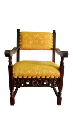 """Consigned Hand-Carved Spanish Yellow Chair - A finely carved vintage Spanish armchair with yellow upholstery. Seat, 19""""H; arm, 26.25""""H to 28.5""""H."""