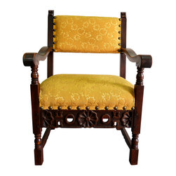 "Consigned Hand-Carved Spanish Yellow Chair - A finely carved vintage Spanish armchair with yellow upholstery. Seat, 19""H; arm, 26.25""H to 28.5""H."
